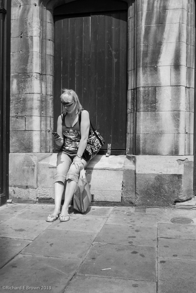 Woman on the Phone - Street shooting with Nikon V1- 10mm f.2.8, 28mm Field of view